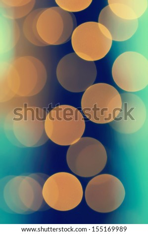 Christmas shiny light bokeh in  blue, green  and yellow colors, vintage retro hipster background