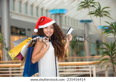 Christmas Shopping. Beautiful Happy Girl With Credit Card In Shopping Mall. Shopping Bags.