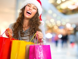 Christmas Shopping. Happy Fashion Woman with Shopping Bags in Shopping Mall.Sales. Christmas Gifts.Shopping Mall. Shopping Clothes