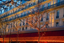 Christmas Shopping in Paris . Street and Showcase Christmas illumination