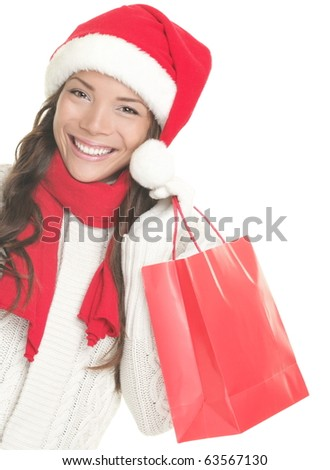 Christmas shopping woman isolated on white background.