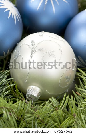 Christmas silver and blue globes on pine tree