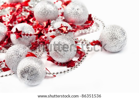 Christmas silver balls and red stars on white