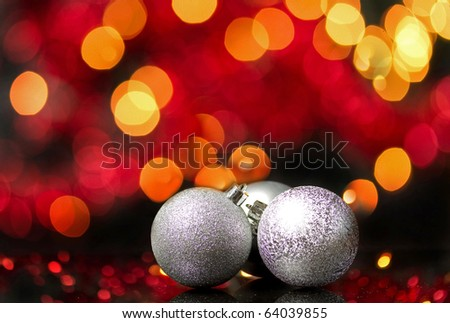 Christmas silver balls with abstract lights background