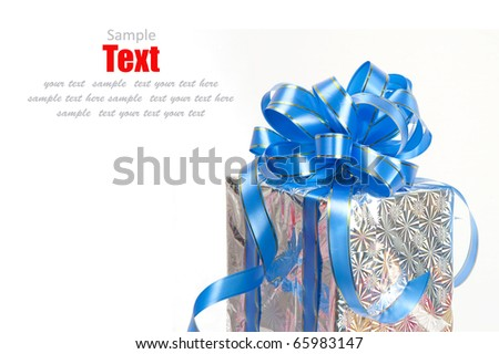 Christmas Silver gift box tied with blue ribbon bow on white background