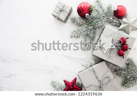 Christmas silver handmade gift boxes on white marble background top view. Merry Christmas greeting card, frame. Winter xmas holiday theme. Happy New Year. Noel. Flat lay #1224319636