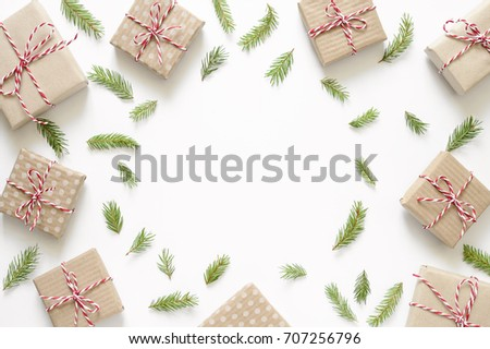 Christmas simple background with simple paper wrapped presents put around, flat lay, view from above, space for a text #707256796