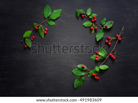 Christmas simple rustic dark background with a space for a greeting text, flat lay