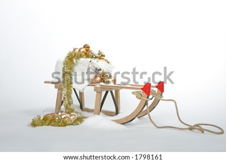 christmas sleigh with golden ornaments