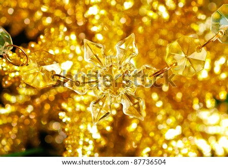 Christmas snowflake on golden sparkle background.