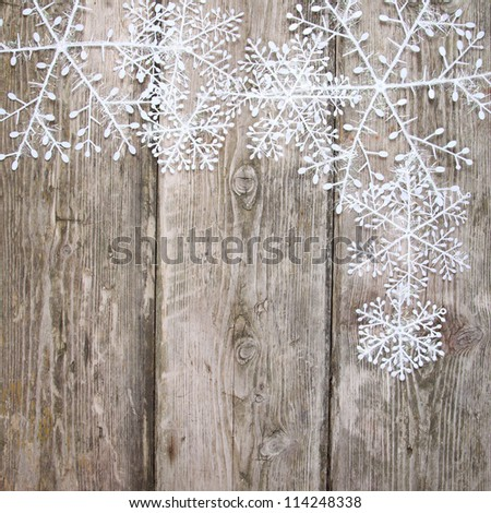 Christmas snowflakes, on a wooden background
