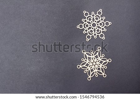 Photo of Christmas snowflakes on black background. Free copy space. New year background.