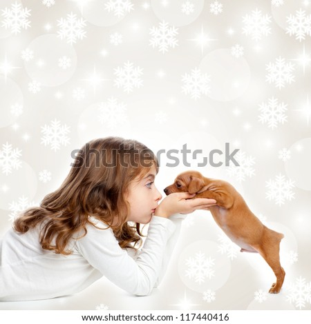 christmas snowflakes with children girl hugging a puppy brown dog