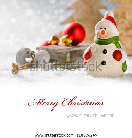 Christmas snowman with presents in winter forest with copyspace