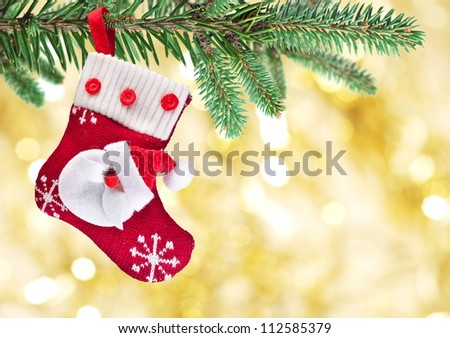 Christmas sock with Santa Claus on on fir branch.