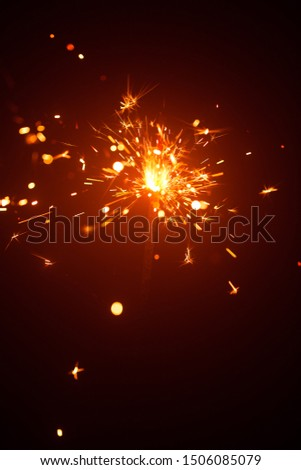 Christmas sparkler in haze with red light #1506085079
