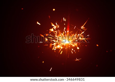 Christmas sparkler in haze with red light #346649831