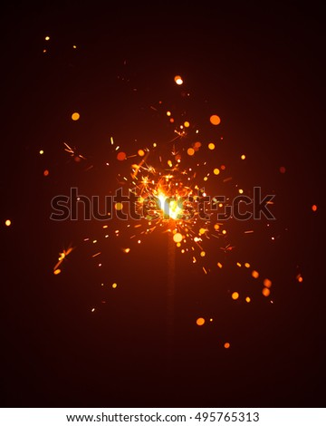 Christmas sparkler in haze with red light #495765313