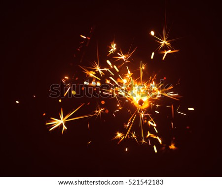 Christmas sparkler in haze with red light #521542183