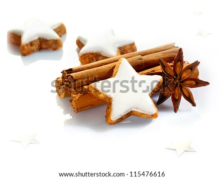 Christmas spices and stars still life with delicious star-shaped cookies, cinnamon sticks and star anise on a white background #115476616