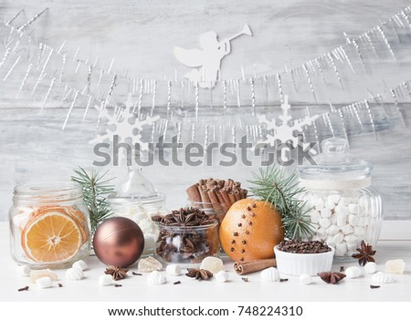 Christmas spices and sweets on a white wooden background. Close up #748224310
