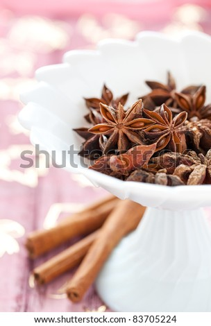 christmas spices anise and cinnamon in bowl
