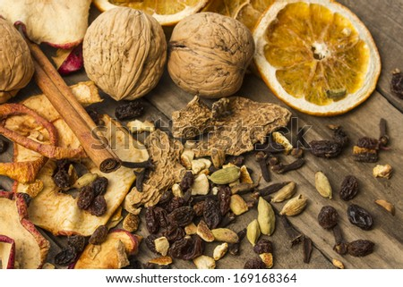 Christmas spices, cookies, nuts and fruits. Shallow dof.