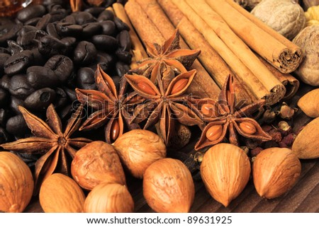 Christmas spices. Cooking ingredients: cinnamon sticks, clove and star anise. Various nuts.