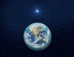 Christmas Star of Bethlehem Nativity, christmas of Jesus Christ. Planet Earth on dark blue night sky with bright star. Elements of this image furnished by NASA