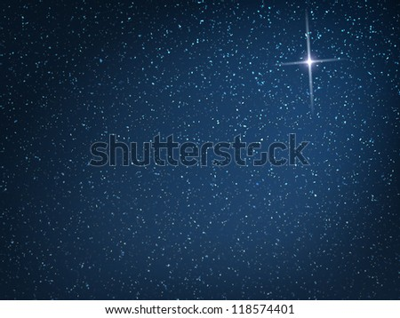 Christmas star on evening snowfall