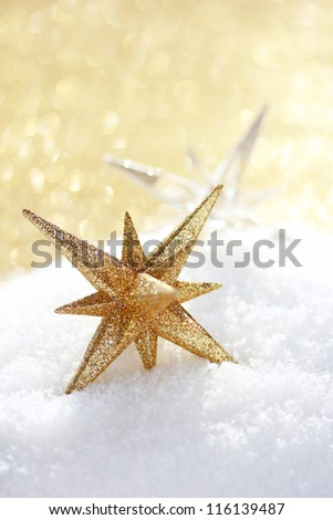 Christmas star ornaments in snow