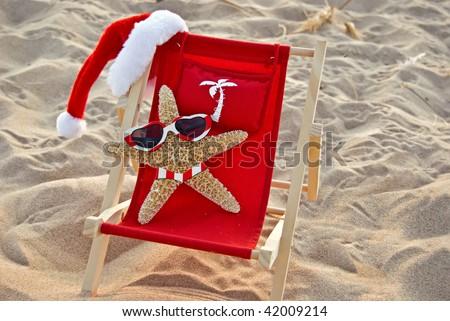 christmas starfish in beach chair - stock photo