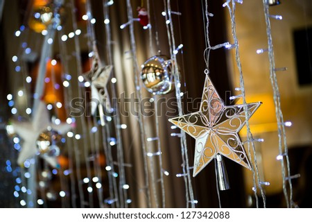 Christmas stars hanging with light ribbon.