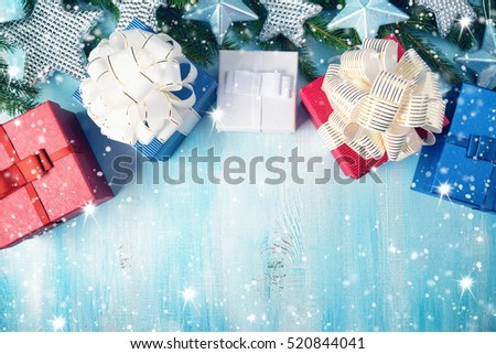 Christmas stars on wooden background with fir tree branches. Winter background with presents #520844041
