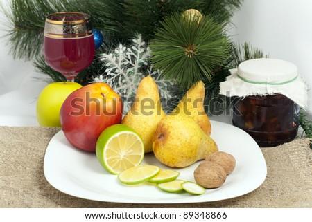 Christmas still life of fruit and jam jars