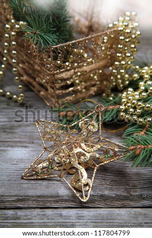 Christmas still life with a golden basket on a wooden table