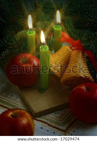 christmas still life with an apples and candles
