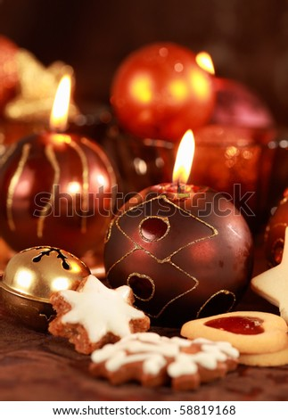 Christmas still life with candles and cookies in brown and red tone