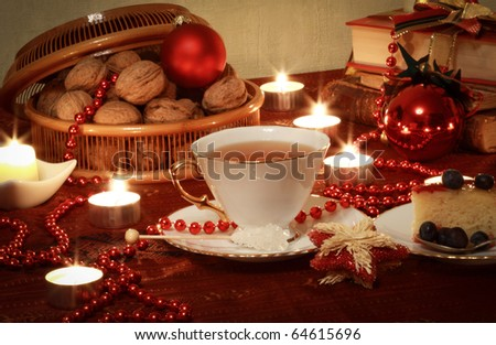 Christmas Still Life With Candles, Books, Balls and Tea