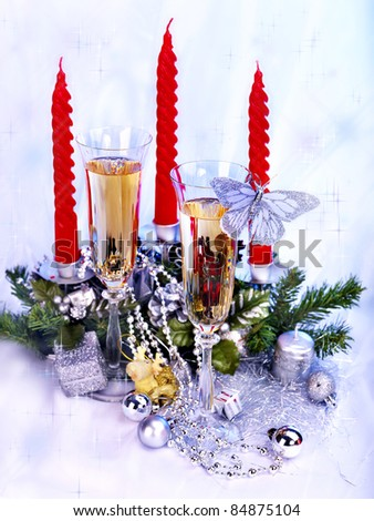 Christmas still life with champagne and candle. Holiday decoration.