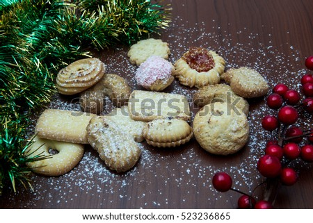 Christmas still life with ginger honey biscuits, ornaments, pine, shoes,gift ,wreaths chocolate candy on a wooden background #523236865