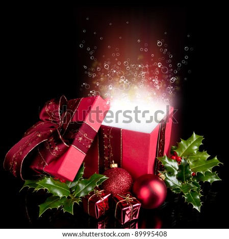 Christmas still life with opened gift and bubbles inside
