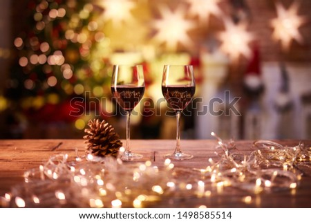Christmas still life with with glasses of red wine - cosy winter time. #1498585514