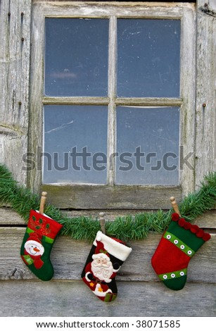 christmas stocking hung under old window - stock photo