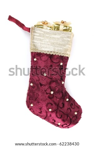 Christmas stocking with present isolated on white background