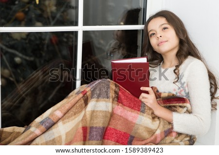 Christmas story that grabs imagination. Little girl read and imagine. Book offers scope for childs imagination. Cute dreamer. Kids imagination and fantasy. Imagination has no limit.