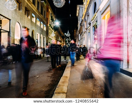 Christmas street and store ornaments on famous fashion street Via Montenapoleone, in Milan - PURPOSELY BLURRED