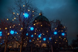 Christmas street light decoration in Berlin with Cathedral (Berliner Dom) in background. Mitte borough of Central Berlin, Germany