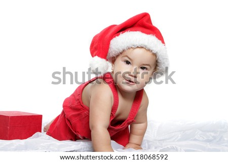 christmas studio portrait of cute child baby in santa hat isolated over white