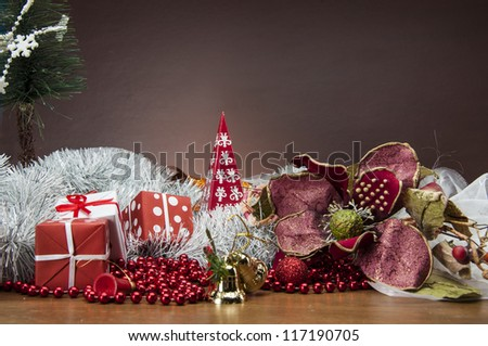 Christmas stuff on wooden table with dark background